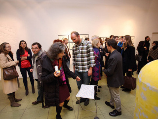 Visitors looking at the work 'Demolition Derby' by Gabriele Edlbauer.